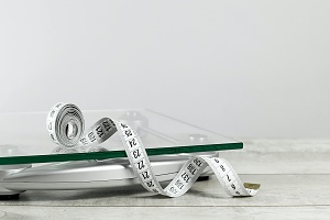white tape measure and scale for Weight Management