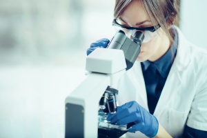 women using a on site Laboratory and microscope