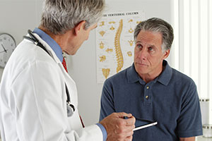 doctor explaining risks after cholesterol screening
